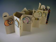 Erin Sweeney: accordion book with pocket, and puppets made and traded with my Stone House students, 2012