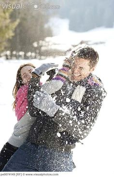 Couple having snowball fight