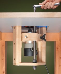 Save $100s by Building Your Own Router Lift!: A router lift makes working at the router table so much easier. Bit height adjustments and even bit changes can all be handled from above the surface. The thing is most commercial lifts cost way more than the router it holds, but with our plans, you can build your own router table lift for about $50. Simple hardware combined with some plywood and maple creates a robust, easy-to-use router lift. Router Lift, Wood Router, Router Woodworking, Woodworking Techniques, Woodworking Furniture, Woodworking Projects, Diy Projects, Furniture Plans, Router Projects