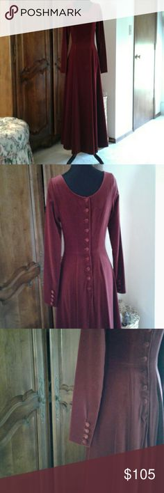 Laura Ashley Burgundy velveteen maxi dress You can dance the night away in this beautiful dress.  At a holiday party or dinner and cocktails you will be the belle of the party in this burgundy velveteen dress princess waist , full flowing skirt covered buttons down the back and at the cuffs. Laura Ashley Dresses Maxi