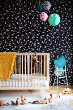 baby nursery with honeycomb paper balls