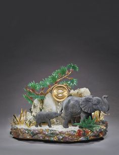 Patek Philippe Elephant Watergames | Lot | Sotheby's A MAGNIFICENT YELLOW AND WHITE GOLD, SILVER, DIAMONDS, RUBIES, JASPER, GREEN AGATE, OBSIDIAN, TOURMALINE, QUARTZ AND ROCK CRYSTAL PRESENTATION TABLE CLOCK MADE IN 1991 lot | Sotheby's