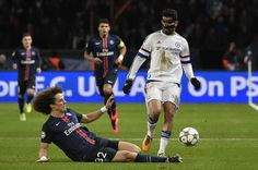 Chelsea's Spanish forward Diego Costa is tackled by Paris Saint-Germain's Brazilian defender David Luiz during the Champions League round of 16 first leg football match between Paris Saint-Germain and Chelsea FC on February 16, 2016, at the Parc des Princes stadium in Paris.