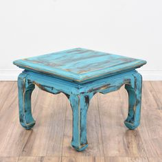 This shabby chic end table is featured in a solid wood with a distressed light blue chalk paint finish. This asian inspired side table is in great condition with curved chow legs, carved trim and a square table top. Great for adding a pop of color to any space! #shabbychic #tables #endtable #sandiegovintage #vintagefurniture