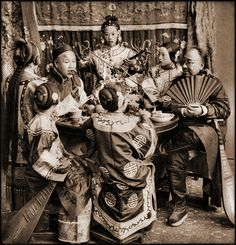 Vintage Photographs of Pre-Revolution China, 1870-1946 - Rich Merchants Dining With Singing Girls, Pekin, China [c1901] Benjamin W. Kilburn