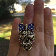 Betsey Johnson skull and bow stretch ring Super cute Betsey Johnson skull and bow stretch ring  It's a heavy ring but I've had no issues wearing it and have always gotten awesome comments on it! Gold tone metal with a little rub off on the stretch band but not very noticeable. Great statement ring for a fun night out with the girls! Fits ring size from about a 6 to 9 depending on which finger you choose to wear it on. Betsey Johnson Jewelry Rings