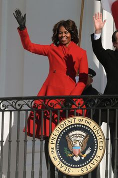 First Lady Michelle Obama arrives to greet French President Francois Hollande during a welcoming ceremony on the South Lawn at the White House in Washington, DC in a Thom Browne coat.| Michelle Obama FLOTUS Fashion Double Shot | Tom & Lorenzo Fabulous & Opinionated
