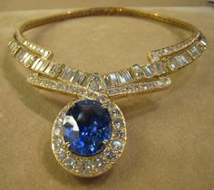 The sapphire is a gem quality 28 carat certified unheated stone. The diamonds in the necklace are all top color and clarity and are estimated to be around 70 carats.