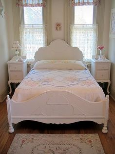 This antique full size bed would be a perfect addition to any cottage chic home. With beautiful curves and details, it has been refinished and painted a linen white and distressed to give it that shabby chic look. The bed includes the headboard and footboard and two side rails.