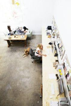 long desks + concrete floor