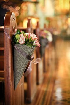 Have flowers in a cone shaped basket hanging off the pews at your Traditional Christian wedding #traditional #christian #wedding