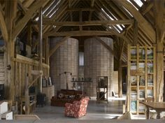 Artist studio within a medieval barn #architecture... 20th century silos were installed to separate the bedroom and living spaces