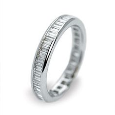 An 18 carat white gold wedding band set with baggett cut diamonds