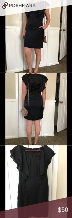 BCBG Little Black Dress In perfect condition. Comes just a little but a nice the knee. Has pockets, which is amazing, but you would never know it. The fit is a little smaller than a typical eight. The lining is super silly and soft, a nice plus. Has ruffles in both sides for the top third of the dress. The dress is 100% polyester. BCBG Dresses