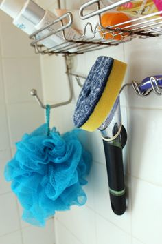 Hang a brush with dish soap and vinegar in the shower for easy cleaning!
