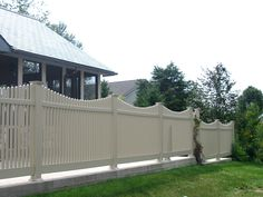 """Erie Picket Fence: Scalloped style, good neighbor vinyl picket fence with 1.5"""" wide, square pickets. Available heights range from 36"""" to 72"""", and standard panel width is 96"""".  Assorted colors offered, including: White, Sandalwood, Adobe, Mocha, Honey Maple and Green Teak.  Looking for something a bit different? This fence can be customized to your unique needs!"""