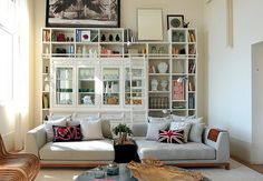 Tall bookcases behind the couch. LOVE