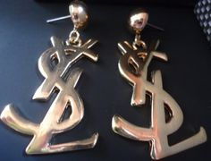 wish these could be mine! Vintage Gold YsL YVES SAINT LAURENT Earrings by goldbunnyvintage