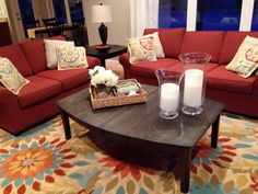 Living Room With Red Sofa And Bright Colorful Flower Rug Couch Love Seat Are Klaussner Sunbrella Material From Jordan S Brick Color Patterned