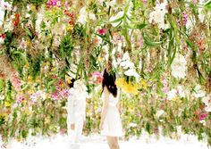 The Floating Flower Garden created by Japanese studio Teamlab is a serene installation engrossed with a vivid and dense canopy of orchids imported from Holland.