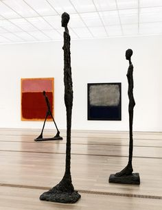 Sculptures by Alberto Giacometti stand near Mark Rothko paintings at the Fondation Beyeler museum.