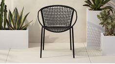 sophia black dining chair | CB2  could order a few of these chairs in black and white to go with the outdoor couch