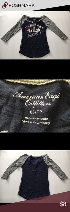 Women's American Eagle Outfitters Shirt XS Gently used shirt with long sleeves; American Eagle Outfitters; Size Extra Small; Made in Cambodia; 77th New York A. Eagle Phys. Ed. on front of shirt American Eagle Outfitters Tops Blouses