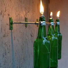 3 Green Beer Bottle Tiki Torches - Garden Light - Modern Outdoor Lighting - hurricane lantern, patio lighting Our tiki torch hardware will add stylish lighting to your backyard and patio. This easy to set up, easy to install kit will set your backyard and patio apart and give you beautiful #modernoutdoorlighting