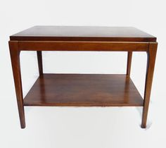 Mid Century Modern Lane Rhythm end table, series 997.  This beautiful 1960s lane walnut end table or side table has beautiful wood and nice clean lines. The design of the 997 series is sleek and minimalist, but with gentle curves to soften the lines. This piece will work well with many design styles.  It is a beautiful example of mid century modern American furniture designed by Adrian Pearsall for Lane. It could also be used as a MCM coffee table. Makers mark and serial number on bottom…