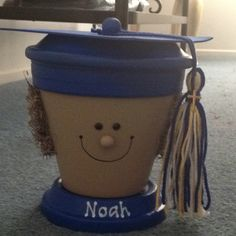Graduation centerpieces or fill the pot with candy and gift cards for a quick and easy present.