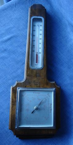 Vintage Collectable Art Deco Wall Weather Station   Barometer & Thermometer by Shortland Smiths (SB).   Made in England.   The thermometer uses red coloured alcohol, not the dangerous mercury.   Solid wood base Im pretty sure its English Oak. Ca. 1920s or 30s  Good used condition as pictured in detail.  Measures ca. 17.5 cm w x 48.5cm h x 4cm d.  Unfortunately Australia Post uses calculated postage and I can only give a fixed postage cost when listing items here. Postage cost to your…