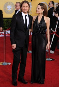 2012 SAG Awards  She looks so much prettier when she smiles.  And he looks like the cat who ate the canary!  MEOW!    Brad Pitt's dapper tuxedo is a Balenciaga by Nicolas Ghesquiere design.
