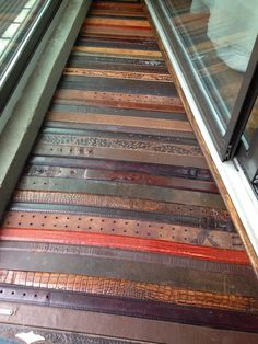The Suels: Repurposed Leather Belt Floors. Re purpose, reuse, recycle. flooring ideas. flooring on a budget.