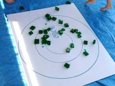 jello toss: Toss to each other or use a traditional bull's eye target on the ground ... which was covered with heavy duty tarp to contain the spillage. Take turns throwing jello jiggler squares at the target, trying for the most points total.