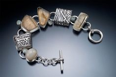 Nancy Blair used a fusing technique to create textures in Lake Powell, a sterling silver linked bracelet with topaz skins and blue topaz. CREDIT: RALPH GABRINER
