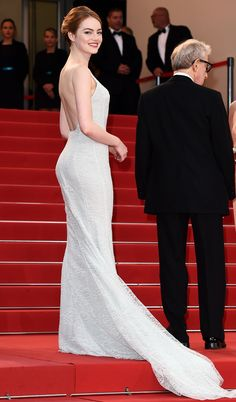 EMMA STONE in backless ivory Dior gown with a Repossi choker at the 2015 premiere of Irrational Man. Cannes 2015.