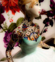 Tattooed porcelain doll by Jessica Harrison