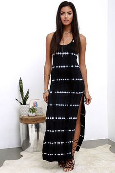 With a lightweight, knit construction and the perfect print, wearing the Desert Villa Black Tie-Dye Maxi Dress will feel like a retreat! Washed black and ivory tie-dye print (with hints of blue) covers a sleeveless, racerback bodice with a bodycon fit. Maxi skirt has twin thigh-high slits.