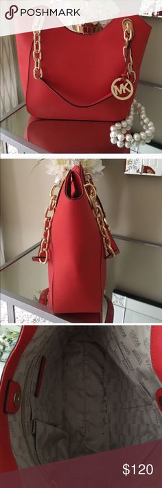 Michael kors used purse in good condition nice Michael kors shoulder purse used in good condition color it's red \ orange super nice cleaning my closet KORS Michael Kors Bags Shoulder Bags