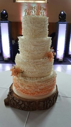 Ombre peach and ivory ruffles wedding cake with lisianthus