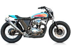 A purdy W650 in Richard Petty NASCAR colours. Pirelli Scorpions, Over 2-into-1 racing exhaust, pipe wrap, custom-drilled bevel cover, alloy tracker tank, tracker seat conversion, custom speedo mount and more.