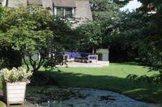 tuin tuinontwerp tuinarchitect hovenier hoveniersbedrijf tuinaanleg beplanting beplantingsplan onderhoud natuurlijke vijver sloot tuin aan water gazon terras