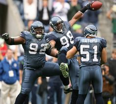 SEATTLE - SEPTEMBER 21:  Linebacker Julian Peterson #98 of the Seattle Seahawks celebrates with Brandon Mebane #92 and Lofa Tatupu #51 after recovering a fumble against the St. Louis Rams