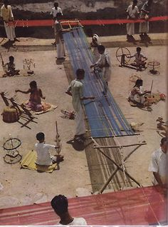 Warping (loom frame, an X with horizontal crossbar at top, held in place by rope to anchor, holds warp rod in place)