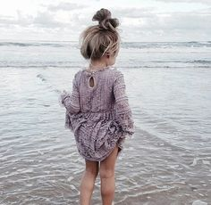 Super cute! Love it when little girls have the cute little messy buns on the top of their head!