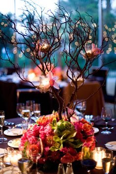 Love how the candles are nestled in the branches instead of hanging from them..great idea.