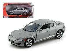 Mazda RX-8 Grey 1/24 Diecast Car Model by Motormax - Brand new 1:24 scale diecast model car of Mazda RX-8 Grey die cast car model by Motormax. Brand new box. Rubber tires. Detailed interior, exterior. Has opening hood and doors. Made of diecast with some plastic parts. Dimensions approximately L-8, W-3.5, H-3.25 inches. Please note that manufacturer may change packing box at anytime. Product will stay exactly the same.-Weight: 2. Height: 6. Width: 11. Box Weight: 2. Box Width: 11. Box…