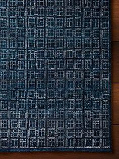 Hand-knotted by talented artisans and adorned with a mesmerizing geometric motif, the Garrett Knotted Area Rug enlivens any space and offers comfort underfoot.