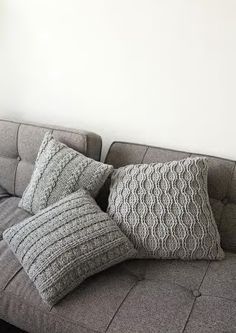 Knitted pillows - I would love to have these in crimson for the living room.