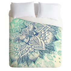 Mature hippies rejoice with this beautiful mandala duvet design by artist RosebudStudio called Lovely Soul Duvet Cover. Available at DENY Designs.